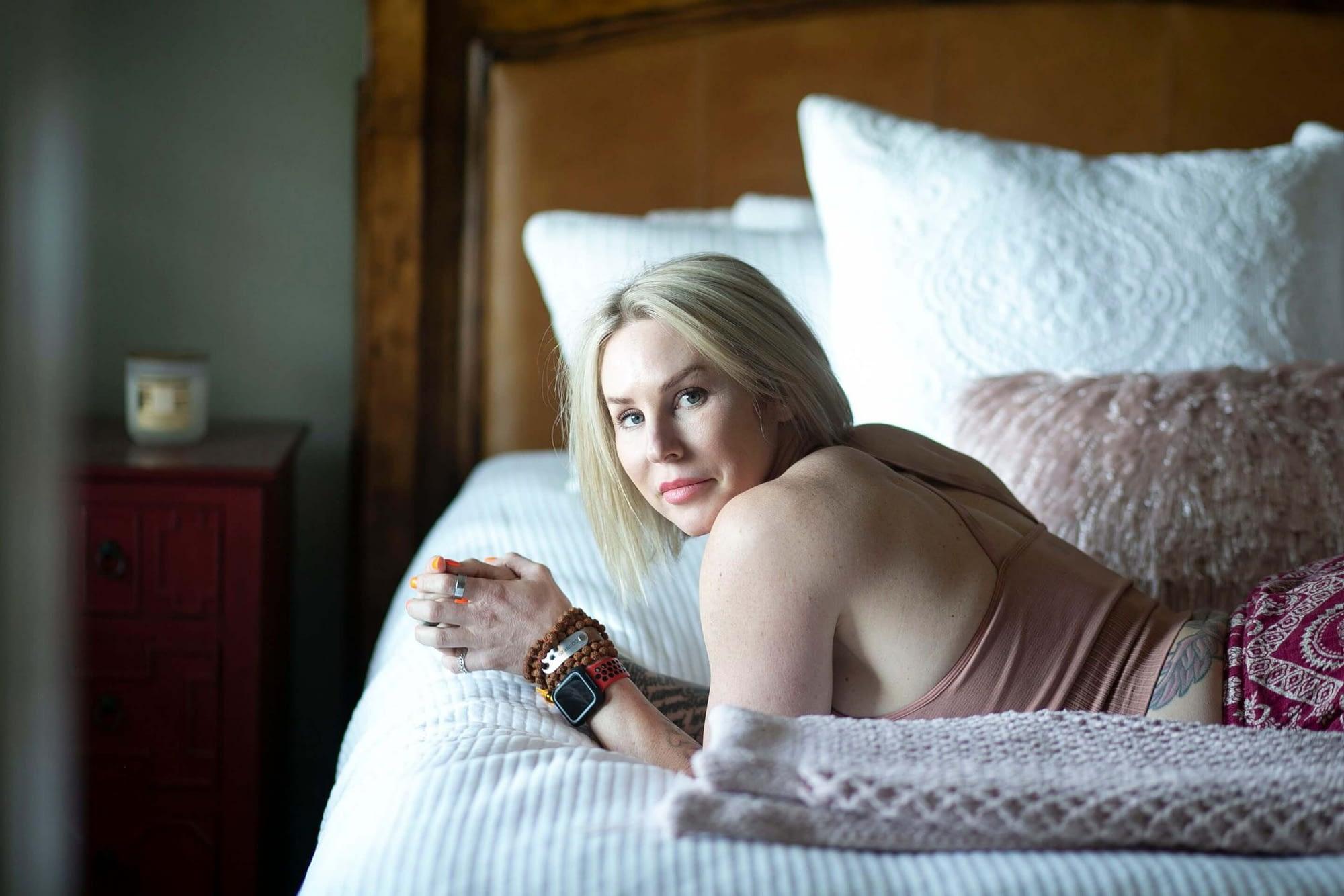 jenn carrasco laying on bed